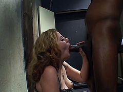 Redhead skank Cherry Poppens shows her hairy pussy to some black dude and favours the guy with a blowjob. Then they bang in cowgirl position and Cherry moans loudly with pleasure.