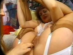 Two nasty lesbians are having some good time together. The redhead one shows her pregnant belly to her GF and allows the slut to finger and toy her meaty vagina.