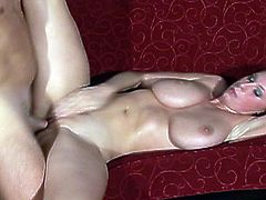 Watch this huge titty brunette babe Gianna Michaels stripping her clothes off and showing those huge fun bags of her's.She is soon joined by her partner who fucks her big tittes and that tight lusty pussy.