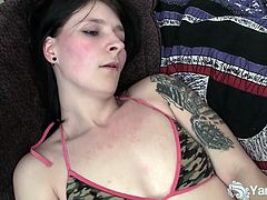Tattooed amateur nymphet Tundra masturbating her wet beaver.Watch how she slowly spreads her legs apart for showing her tight shaved pussy in this hot solo video.