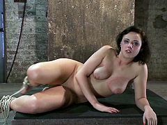 Brunette girl gets tied up in unimaginable acrobatic pose. Then she gets her ass spanked and pussy toyed.