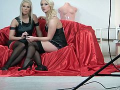 It's all about fucking but what if we add some style and passion into it? Silvia had a great, she brought in two beautiful blondes that are ready to fuck and set the stage. The blondes are sitting on a red couch and wear naughty black costumes. One of them spreads her legs greeting the other, don't miss this action!