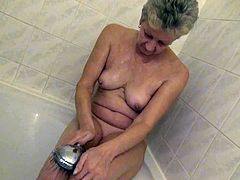 Watch this old but still horny old babe pleasing herself while taking a shower in her bathroom in Old Nanny sex clips.