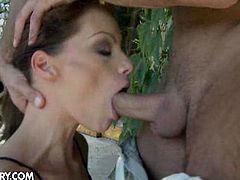 Watch the vicious brunette temptress Sophie Lynx getting her throat banged in the back garden of the house. Then she's ready to ride her man's dong into kingdom come with her hot ass.