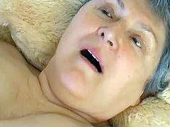 Shameless BBW granny lies in bed totally naked rubbing her huge soft tits and her puffy hairy snapper. Old hoe opens her legs wide and tickles her clit with pink vibrator.