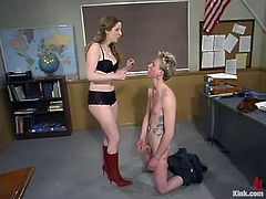 Submissive Ian Frost gets spanked and undressed by his teacher. Later on she also toys him in the ass right in the classroom.