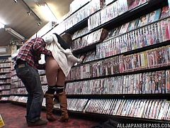 Lewd Japanese girl is playing dirty games with her man at her work place. They pet each other in the book shop and then the dude drills the hussy's snatch from behind.