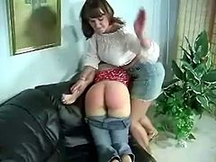 Just because she loves to see her friends ass turns into red, this busty brunette pulled down her friends jeans and spanked her well rounded ass