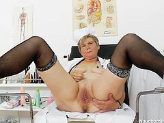 Nurse Berta is a chunky mature with a shaved pussy. She loves to play solo now and then and this time she's all alone in her office and feels horny. Berta doesn't spares her time and makes herself comfortable on the gynecologist table, spreads her thighs and fingers her pussy deep. She then uses a dildo.