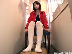 Japanese girl in a swimsuit and stockings pleases a blindfolded man. She gives him skillful footjob and makes him cum easily.