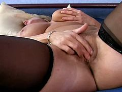 Lustful mature blonde Brenda is having fun in a bedroom. She strips and strokes her big natural boobs and then moves her legs wide apart and pleases herself with fingering.
