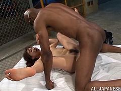 Very interracial gangbang is going on here! Busty and booty Japanese sex doll rides one and sucks two others at the same time.