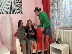 This older couple is ready for some action with a young and innocent cutie. She get involved into this nasty threesome and enjoyed his old cock into her young pussy.