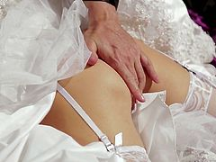 Filthy light haired busty bride lies in big bed and greedily blows guy's big thick cock in a sloppy way. Check out cock sucking skills of that unfaithful bride!