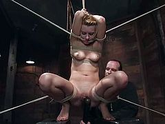 Adorable blonde Lexi Belle gets bound by some horny dude in a basement. The man pleases Lexi with fingering and then drills her vag with a dildo.