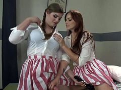 A sexy and masculine tranny and her girlfriend are candy stripers volunteering at a hospital. They take a break to get naughty. The shemale sticks her thick cock in the girl's vagina and pounds her very hard.