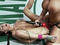 Trina Michaels and Gia Dimarco are having a wrestling match on tatami. The lesbians struggle with each other and then the winner pounds the loser's butt with a strapon.