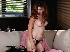 With small tities and clean beaver gives a closeup of her beaver while masturbating with toy