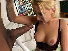 Sexy blonde girl in lingerie gives a blowjob to Black dude. Then she lies down on a sofa and gets her bald pussy licked. She gets fucked in a cowgirl pose.