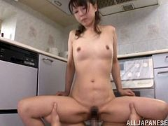 Horny Japanese wife gets her boobs and ass fondled through clothes. Then the guy fingers and fucks her hot pussy in the kitchen.