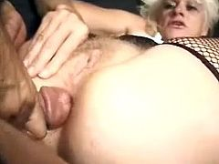 Slutty blonde granny Kathy Jones is trying to please some stud. She kneels in front of the dude and does everything to milk his fat cock dry.