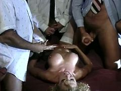 Juicy light haired hussy gets her tight soaking cunt fucked by five cocky guys doggystyle. Bitch lies on her back later and gets her body covered with five loads of cum.