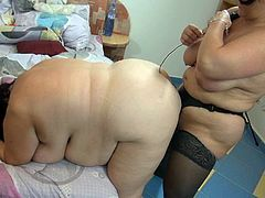 Check out how morbidly obese BBW brunette mommy gets ger stinky fat cunt fucked doggystyle with big strapon by her ugly lesbo girlfriend.