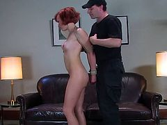 Poor redhead chick strips her clothes off at a casting. After that she gets tied up and fingered. Later on she also gets toyed.