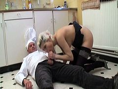 Hot blonde chick in sexy stockings blows stiff cock and then gets fucked and slammed by the cook on the floor of the kitchen before cumming in her warm pussy!