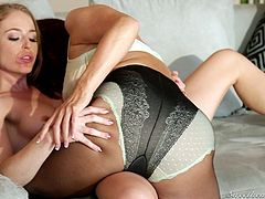 Sexy mature lady Mags takes her young friend onto the couch and kisses her to show her love. The two lesbian women take off each other's clothes and explore every inch on their bodies with their tongues and hands.