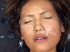 Sweetie likes feeling the creamy load covering her face in sexy bukkake porn scene
