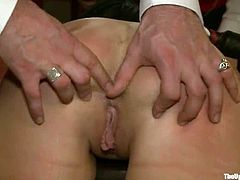 Dylan Ryan is getting naughty with Mark Davis and some other people in a living room. Dylan gets bound and enjoys having Mark's cock in her mouth and tight vag.