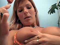 Curvy blonde smears her tits with ice cream and shows her cunt to some guy. Then she kneels in front of the man and sucks his cock till it explodes with jizz.