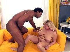 Naughty blonde MILF gives stout blowjob to BBC. She is penetrated in her shaved pussy hole in sideways position. Later on she is hammered bad doggy style. Awesome interracial fuck video presented by Fame Digital.