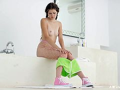 Lovely brown-haired chick Vanessa is getting naughty in the bathroom. She strokes her slim body passionately and then pours water on her shaved coochie.