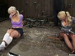 Lovely blonde girls get bounded by their brunette mistress. These girls get their pussies toyed with a strap-on.