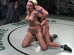 Delilah Strong is not strong enough, so she loses a fight to Vendetta. She sucks a strap-on passionately and then gets her vagina drilled from behind.