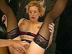 After having a great fuck, blonde chick gets covered with jizz over her sexy glasses