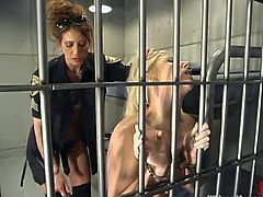 Sexy blonde girl gets undressed and tied by by a brunette in police uniform. Then she gets humiliated and toyed from behind in hot femdom video.