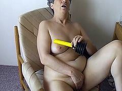 Grease granny with insatiable lust pokes her twat with smooth dildo. She changes the tool to the carrot. Damn, this granny is wacky. She masturbates on a balcony so she could be caught by her neighbors any time.