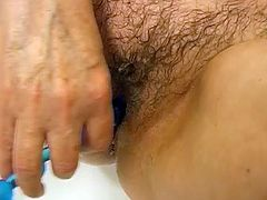 Plump granny is happy to please her wet hairy pussy with vaginal beads in bathtub. Check out that old whore in glasses drilling her filthy snatch with sex toy.