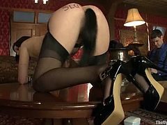 Brunette girl in stockings and high heels gets tied up. After that she gets her pussy toyed. Her master also fixes clothespins to her nipples.