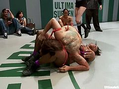 Three chicks in bikini wrestle in a catfight show. Then one of the girls gets her pussy licked and fingered right in a ring in public.
