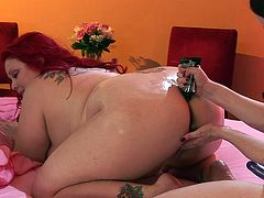 Check out a bbw redheaded slut and her brunette friend having fun with a bottle and with a huge strapon! The bbw chick enjoys the hardcore fuck