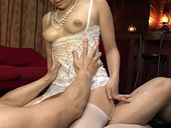 Mesmerizing black haired Japanese mommy with nice tits and ass gives blowjobs to two guys and then rides those stiff dicks in cowgirl pose in turn.