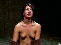 Lovely brunette girl strips her clothes off and lies down on the floor. Later on she gets hit by electricity. Later on she gets toyed with electro dildos by Bobbi Starr and Isis Love.