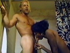 A short-haired black hussy is having fun with some guy. She lets him eat her throbbing snatch and then sucks his weiner till it explodes with cum.