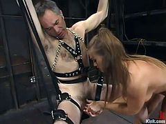 Ed Stone and Rita Faltoyano are getting naughty in a basement. Rita binds Ed and makes him lick her feet and then pulls him by the cock and fucks his ass with a strapon.