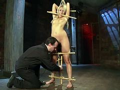 Stunning blonde girl gets undressed and tied up by her unmerciful master. She sits on the floor and gets her pussy toyed for a long time.