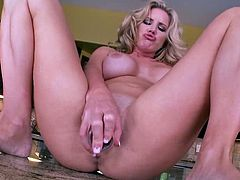 Curvaceous blonde chick poses in wet t-shirt. Then she lie down on a table and plays with her hot pussy. She also licks the banana and starts to shove it deep in her vagina.